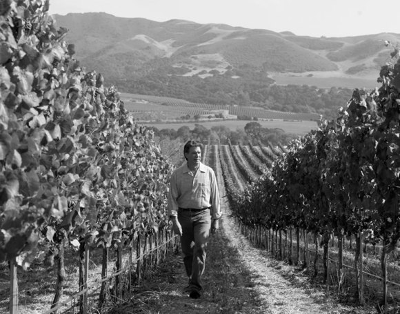 Rick Longoria walking his vineyard